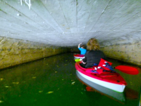 Guiding our boats through the tunnel with our hands while trying to avoid the ridiculous amount of spider webs.