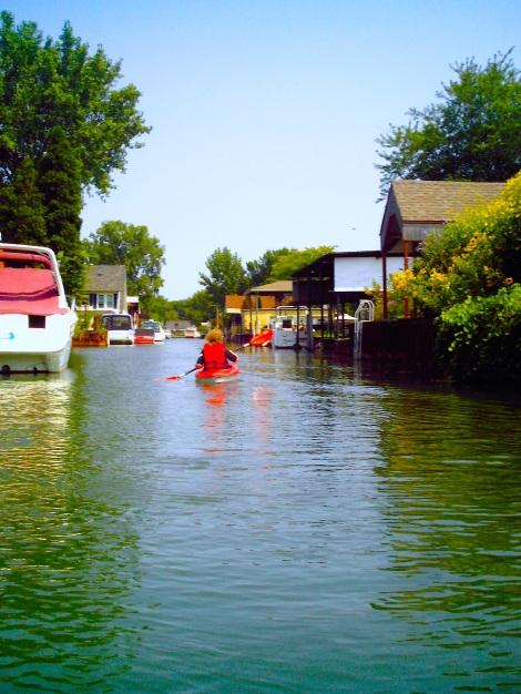 Kayaking through the neighborhood.